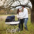 Parents with baby in vintage pram — Stock Photo #52817279