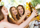 Friends drinking beer in pub — Stock Photo