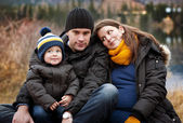 Family sitting on pier — Stock Photo