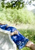 Pregnant woman relaxing on armchair — Stock Photo