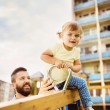 Father and daughter on playground. — Stock Photo #53552183