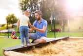 Father and daughter playing on playground. — Stock Photo