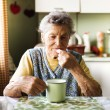 Old woman is taking pills — Stock Photo #53746467