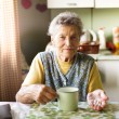 Old woman is taking pills — Stock Photo #53746511