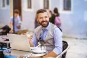 Businessman working during lunch time — Stock Photo