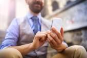 Businessman using smart phone — Stock Photo