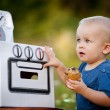 Boy playing with toy oven — Stock Photo #54845435