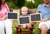 Family with boy sitting on chairs — Stock Photo