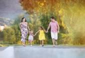 Family having fun on the road — Stock Photo