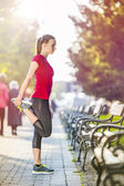 Female runner is jogging in the city — Stock Photo