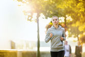 Runner is jogging in the city — Stockfoto