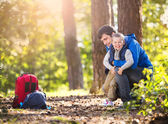 Father and son in the forest — Stock Photo