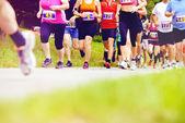 Group of marathon racers running — Stock Photo