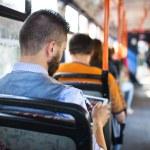 Man using digital tablet in tram — Stock Photo #55291543