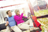 Hikers couple going up by cableway — Stock Photo