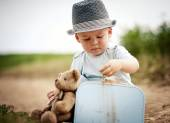 Little boy playing with teddy bear — Stock Photo