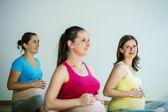 Pregnant women doing relaxation exercise — Zdjęcie stockowe