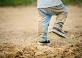 Little boy in dirty jeans — Stock Photo