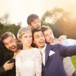 Bride, groom and his friends taking selfie — Stock Photo #55449115