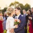 Newlyweds kissing at wedding reception — Stock Photo #55450165