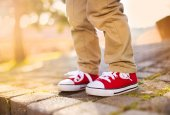 Boy standing on tiled pavement — Stock Photo