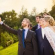 Bride, groom and his friends taking selfie — Stock Photo #55499685