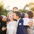 Bride with groom and his friends taking selfie — Stock Photo #55510577