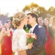 Newlyweds kissing at wedding reception — Stock Photo #55510665