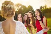 Surprised bridesmaids looking at bride — Stock Photo
