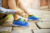 Female athlete tying sport shoes — Stock Photo