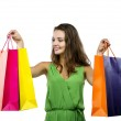 Woman posing with shopping bags — Stock Photo #56086285