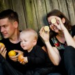 Family having fun with oranges — Stock Photo #56086381