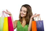 Woman posing with shopping bags — Stock Photo