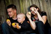 Family having fun with oranges — Stock Photo