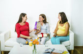 Pregnant women looking at baby shower gifts — Stock Photo