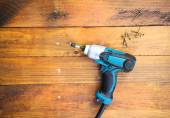 Electric drill and nail left — Stock Photo
