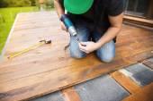 Handyman working with drilling machine — Stock Photo