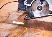 Grinder machine grinding planks — Stock Photo