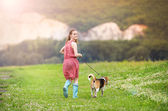 Girl running with her dog — Stock Photo