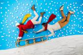 Young couple on sledge having fun — Stock Photo