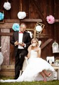 Bride and groom at vintage style wedding — Stock Photo