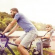 Father with daughter on bicycle — Stock Photo #58184057