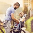 Father with daughter on bicycle — Stock Photo #58184077