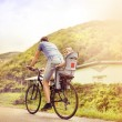 Father with daughter on bicycle — Stock Photo #58184165