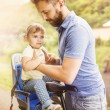 Father with daughter on bicycle — Stock Photo #58184171