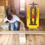 Hands measuring wood flooring — Stock Photo #58184627