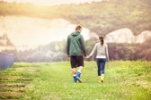 Couple in colorful wellies walking — Stock Photo