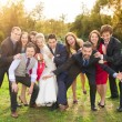 Newlywed couple having fun with bridesmaids and groomsmen — Stock Photo #58277469