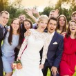 Newlywed couple having fun with bridesmaids and groomsmen — Stock Photo #58277505