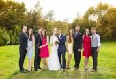 Bridesmaids and groomsmen in sunny park — Stock Photo